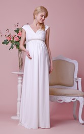 Jersey Jeweled Empire Waist Cap-Sleeved V-Neckline Gown