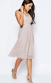 A-Line Sleeveless Scoop-Neck Beaded Knee-Length Tulle Bridesmaid Dress