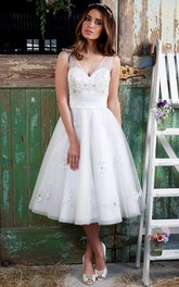Plunged Sleeveless Tea-length Wedding Dress With Beading And Tulle Overlay