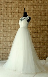 Bateau Sleeveless A-line Tulle Wedding Dress With Applique And Illusion top